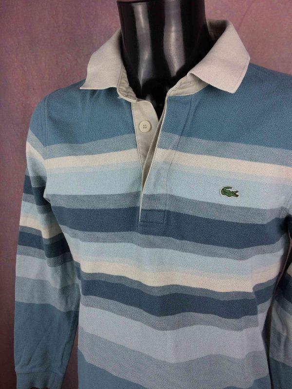 """LACOSTE Polo Maillot Jersey Production Devanlay Vintage 90s Crocodile Court Tennis Rayé Polos LACOSTE Production Devanlay True Vintage MENSURATIONS : Taille indiquée / Tag size: M - d'aisselle à aisselle = 50 cm / armpit to armpit: 19.68"""" - du col au bas du vêtement = 72 cm / from collar to bottom: 28.34"""" - manches: 50 cm / sleeves: 19.68"""" 100% coton 399g GOOD CONDITION ! BON ETAT!"""