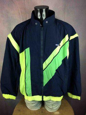 Veste ELLESSE, Véritable vintage Année 90s, Manches détachables par des zips, Intérieur doublé, Gilet Sport Old School