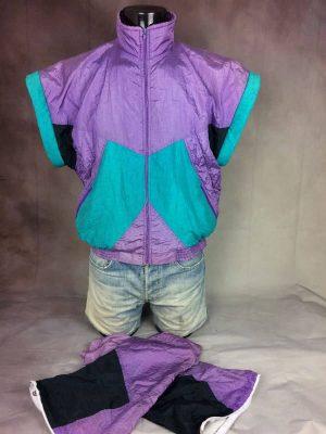 Veste Tilt, New Sportswear, Véritable Vintage Années 90s, Toile Parachute, 100% Nylon, Manches Amovibles, Taille S / M, Couleur Violet, Vert et Noir, France Sport Unisexe